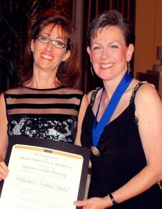 2012 VSAIA President, Lori Garrett, AIA, presents the 2012 Noland Award to Helene Combs Dreiling, FAIA