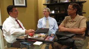 Del. Dave Albo (L), Shaun Curran AIA, and Kathryn Prigmore FAIA confer on the Virginia Public Procurement Act in Delegate Albo's Springfield office.