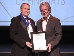 Jack Davis accepts Noland certificate