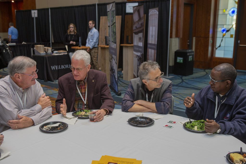 Old friends and new caught up over lunch in the ArchEx Exhibit Hall.